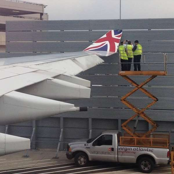 The wing of a London-bound Virgin Atlantic plane