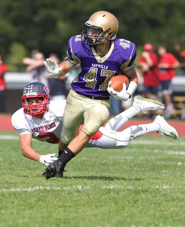 Sayville's Michael Dinisio (47) makes a catch and