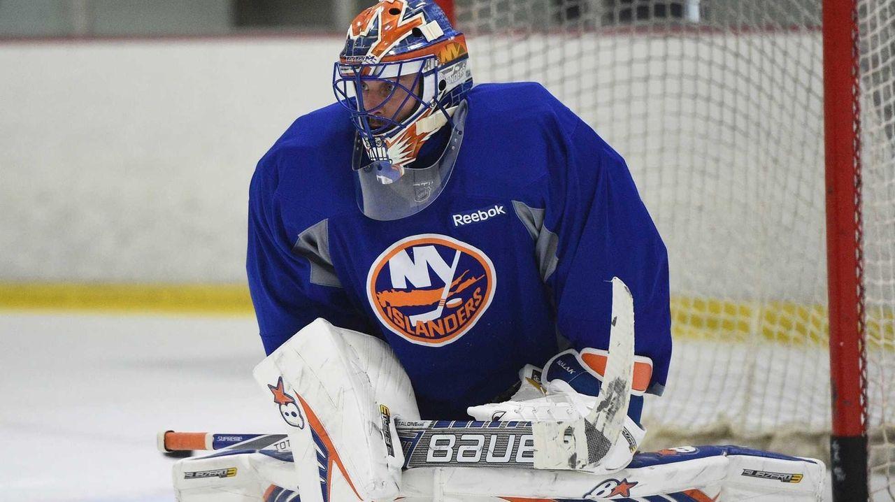 New York Islanders goalie Jaroslav Halak protects the