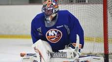 New York Islanders goalie Jaroslav Halak protects the