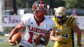 Plainedge's no. 14 Davien Kuinlan breaks through Bethpage's