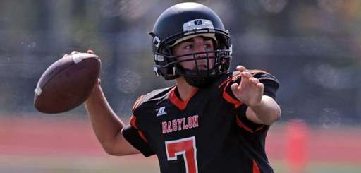 Babylon quarterback Scott Sasso throws for a first