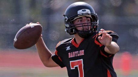 Babylon quarterback Scott Sasso throws for a first