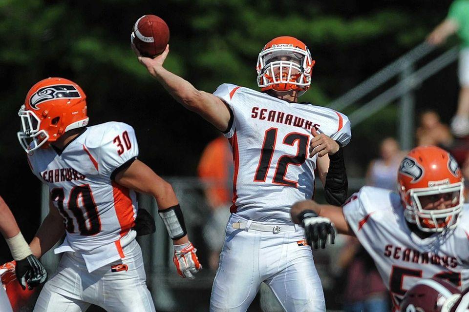 Carey quarterback No. 12 Mike Catanese throws a