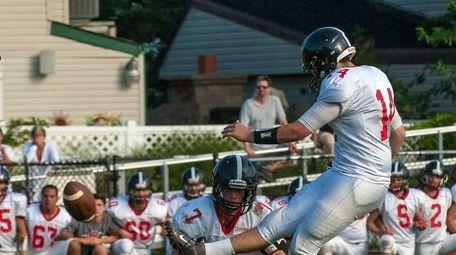 Syosset's Cameron Biegel (14) kicks the winning field