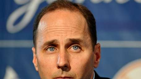 Yankees GM Brian Cashman looks on during a