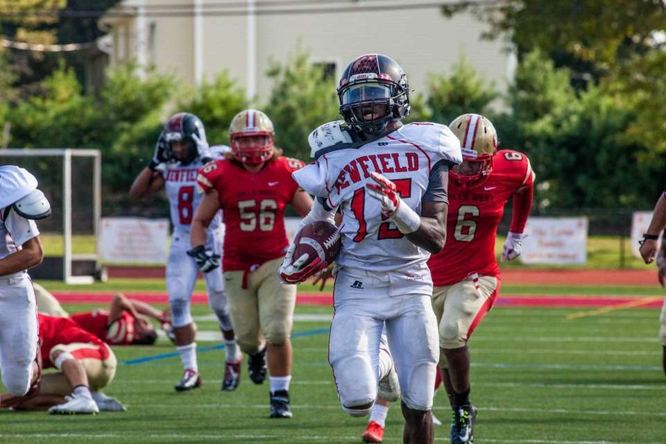 Newfield wide receiver Jelani Greene runs for a