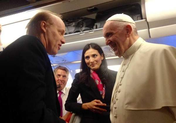 Pope Francis greets journalists including Bart Jones of