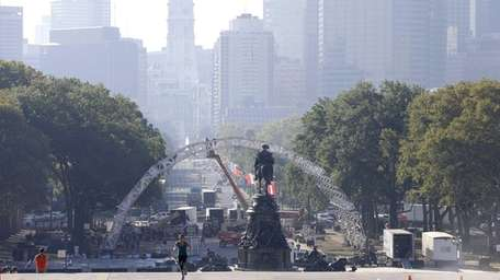 Workers build a stage ahead of Pope Francis'