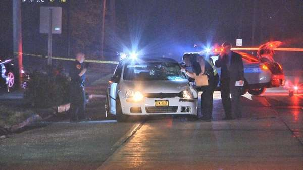 Suffolk County Police Fifth Squad detectives investigate a