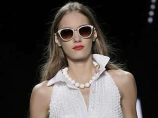 A model walks the runway at the Spring