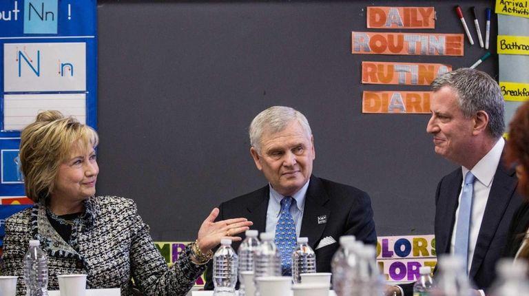Former U.S. Secretary of State Hillary Clinton, left,
