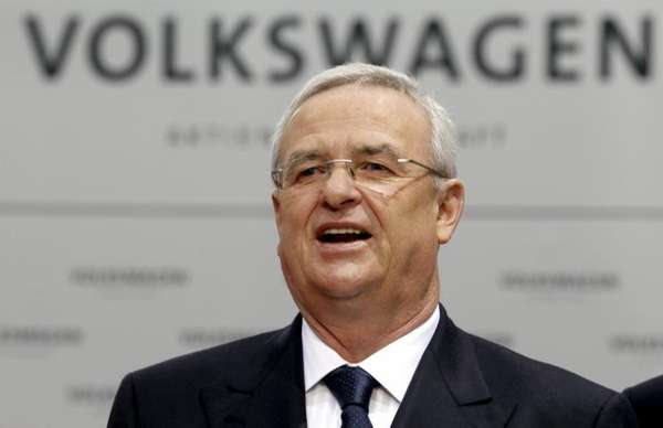 Volkswagen CEO Martin Winterkorn talks to the media