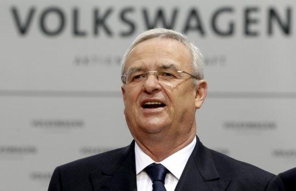 Volkswagen CEO Martin Winterkorn talks to the media