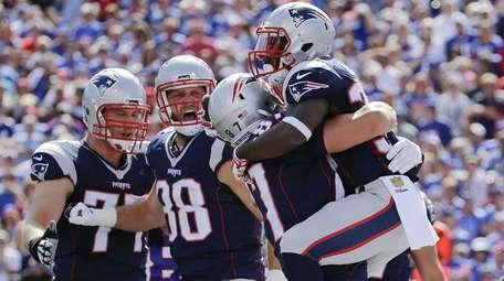 New England Patriots' Dion Lewis, right, celebrates with