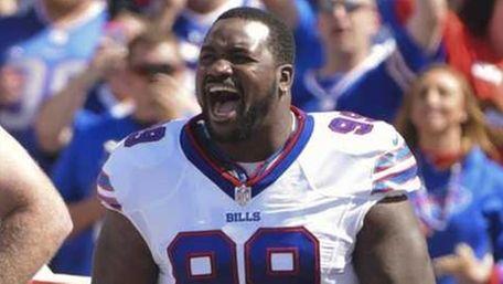 Buffalo Bills' Marcell Dareus (99), Kyle Williams (95)