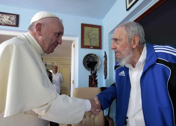Pope Francis and Cuba's Fidel Castro shake hands