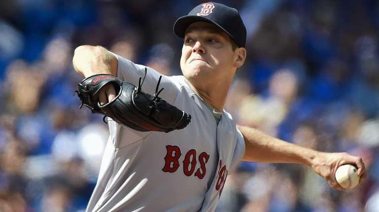 Boston Red Sox' starting pitcher Rich Hill works
