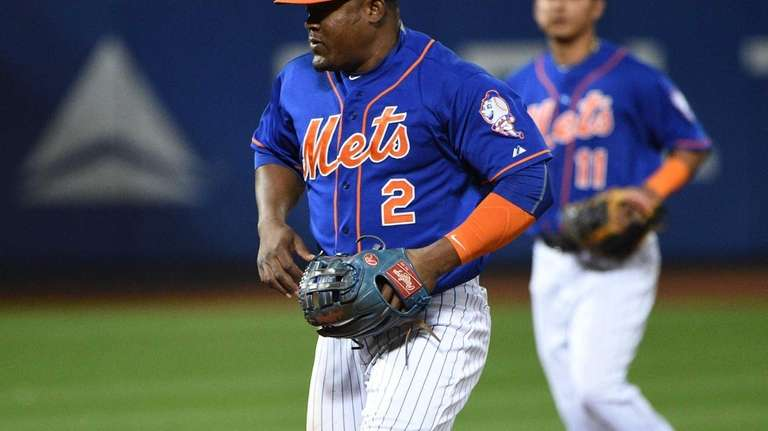 The ball gets past New York Mets second