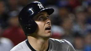 New York Yankees second baseman Dustin Ackley watches