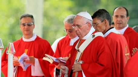 Pope Francis leads a Mass for Catholic faithful