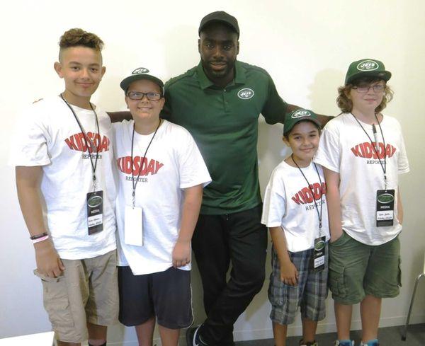 Kidsday reporters with New York Jets linebacker DeMario