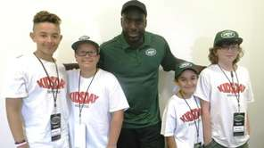 Kidsday reporters with New York Jets linebacker DeMario