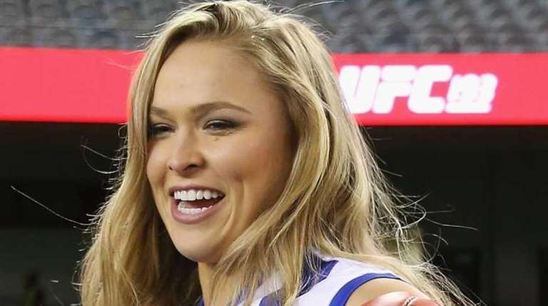 UFC fighter Ronda Rousey wears a Kangaroos AFL
