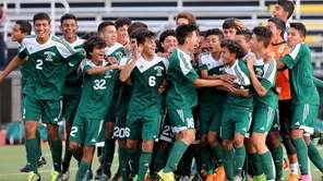Brentwood celebrates its 3-2 victory over Commack on