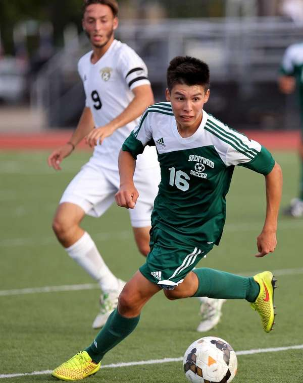 Brentwood's Alejandro Callejas intercepts the Commack pass and