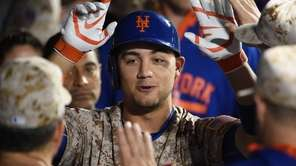 New York Mets leftfielder Michael Conforto is greeted