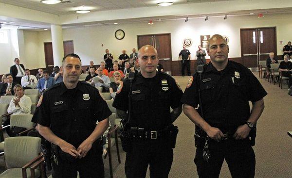 From left, Nassau Police officers Joseph Altieri, Michael