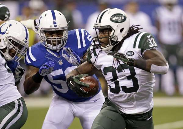 Indianapolis Colts outside linebacker Trent Cole (58) chases