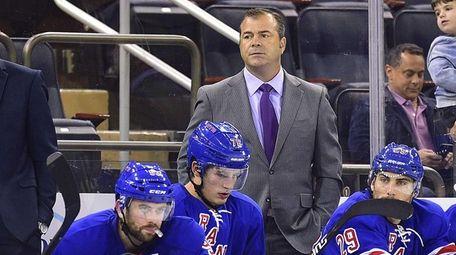 New York Rangers head coach Alain Vigneault looks
