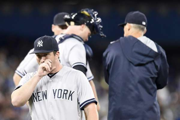 New York Yankees starting pitcher Adam Warren, bottom