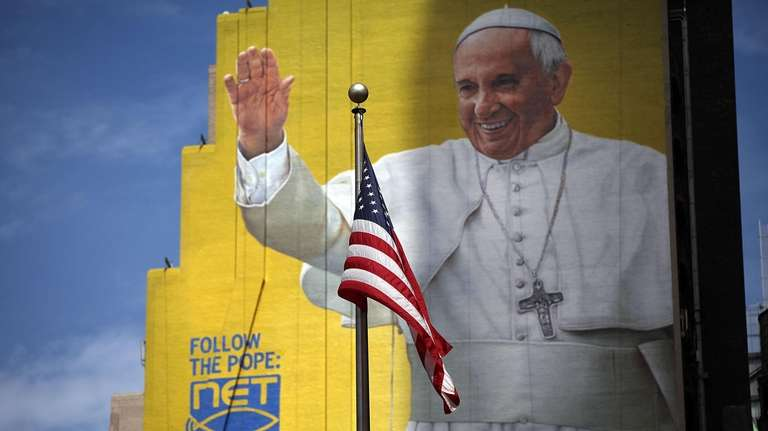 A completed mural of Pope Francis is viewed