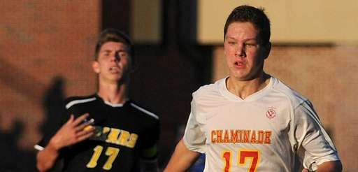 Chaminade's Matthew Vowinkel looks to gain possession of