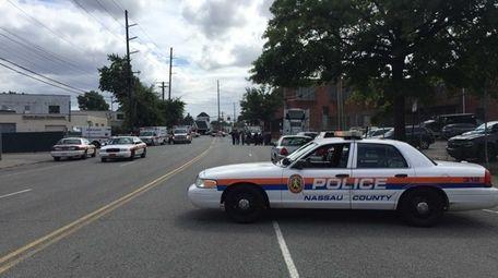 Nassau police cars block Denton Road during an
