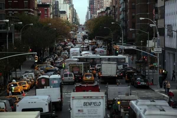 Vehicles sit in traffic on 10th Avenue in