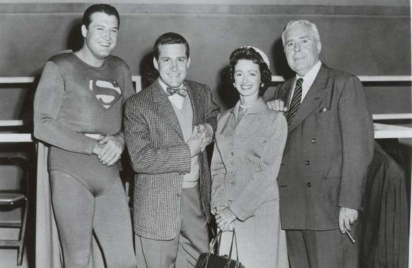 Jack Larson as Jimmy Olsen, in bow tie,