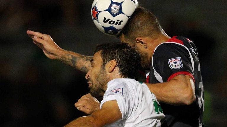 Ottawa Fury defender Rafael Alves #33 heads the