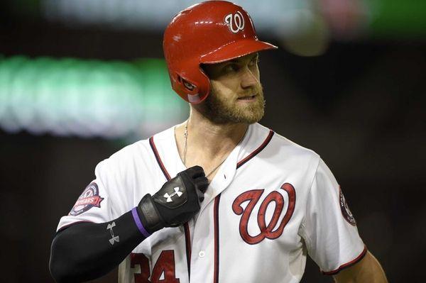 Washington Nationals' Bryce Harper walks back to the