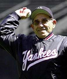 Former Yankees catcher Yogi Berra throws out the