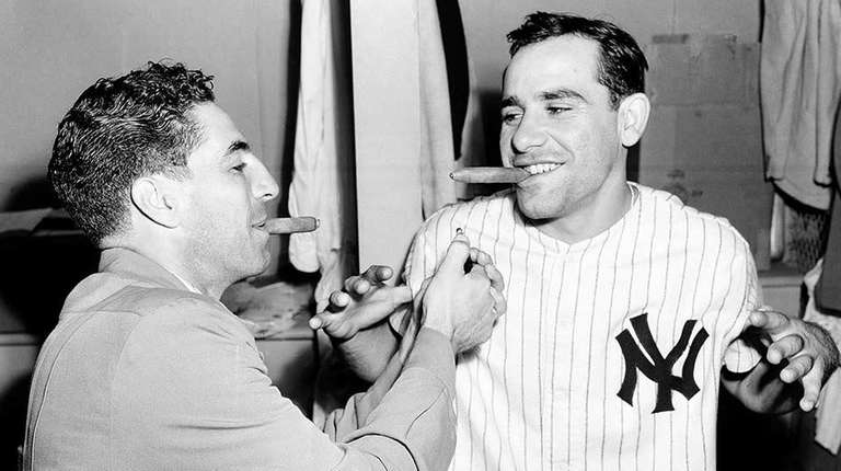 New York Yankees catcher Yogi Berra, right, accepts