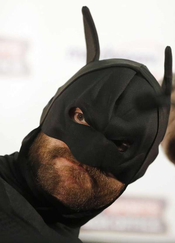 British heavyweight Tyson Fury poses in a Batman