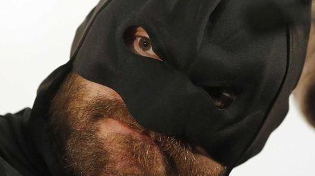 British heavyweight Tyson Fury poses in a Batman