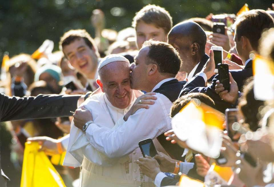 Pope Francis receives a kiss outside the Apostolic