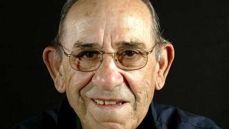 Yankees great Yogi Berra is photographed with his
