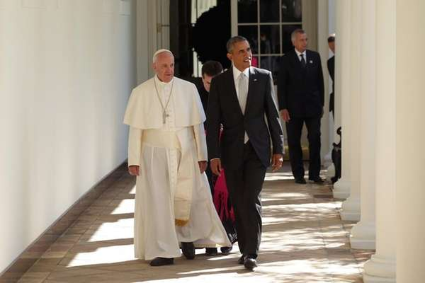 U.S. President Barack Obama escorts Pope Francis down