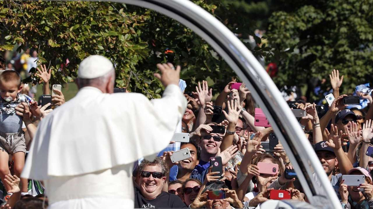 Pope Francis greets the crowd on Sept. 23,